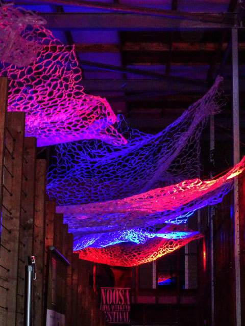 'Ebb and Flow' lit in red and pink – recycled plastic – 20m long x 5m wide – variable